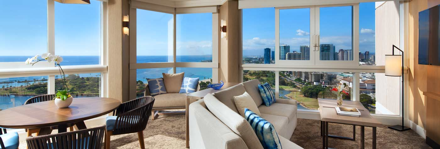 Hotel suite with view of ocean, harbor and city.
