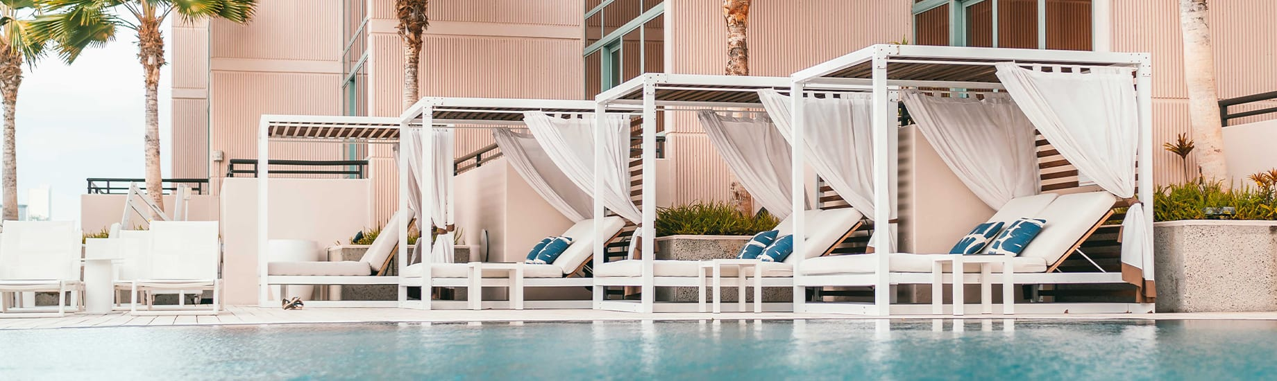 Hotel pool and ocean view cabanas.