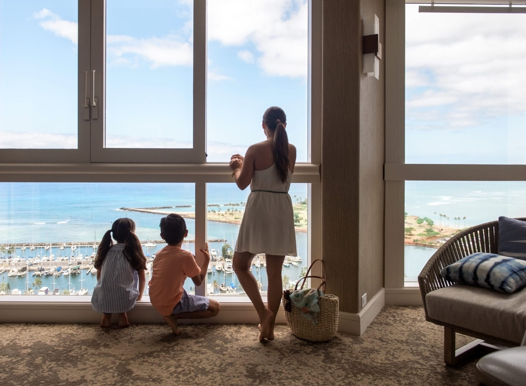 Family enjoying the view from a suite.