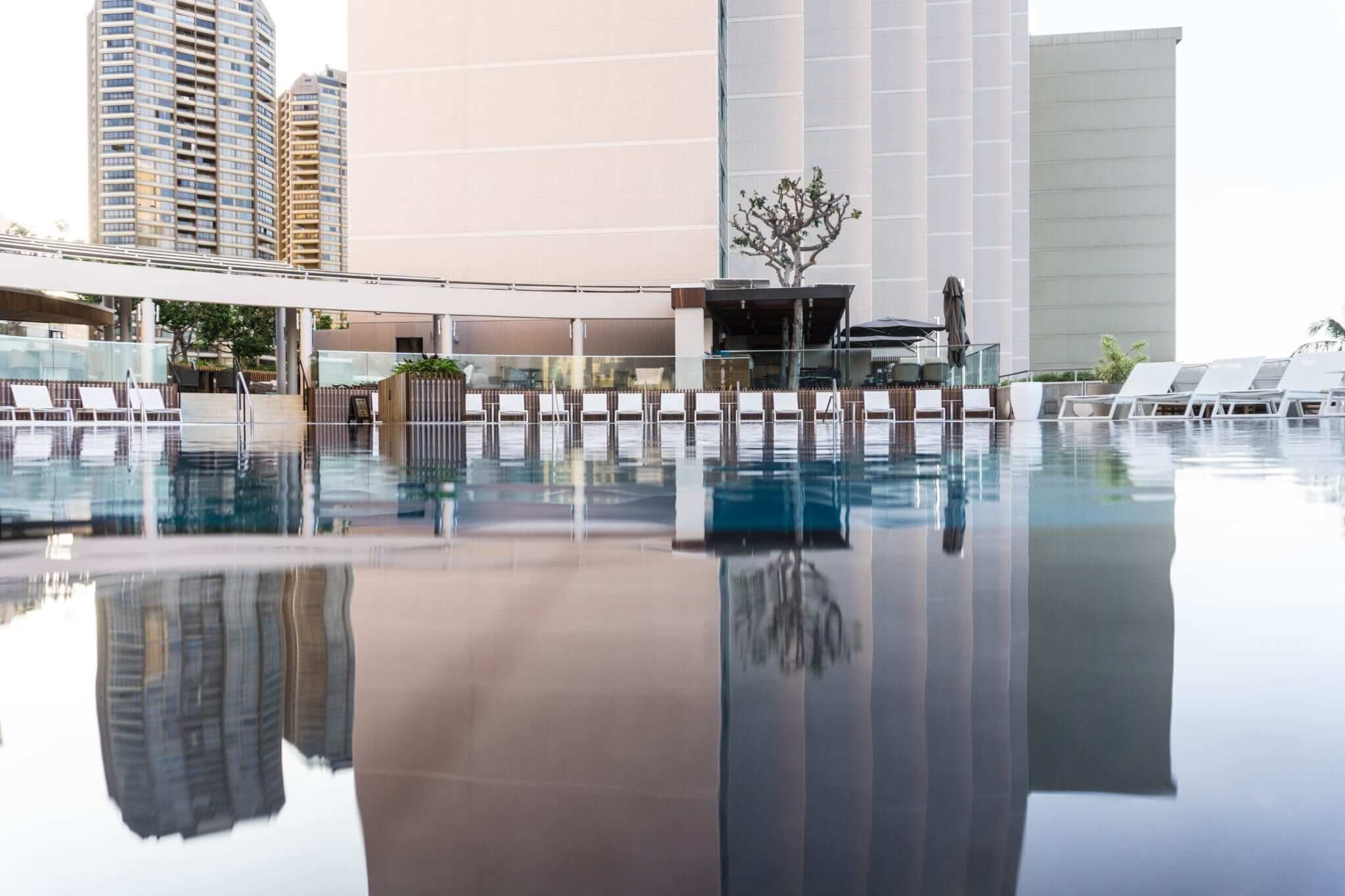 Hotel pool with water reflected.