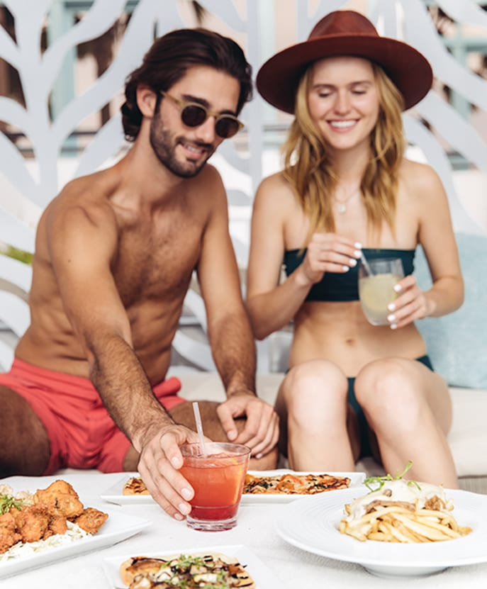 Couple dining in a cabana.