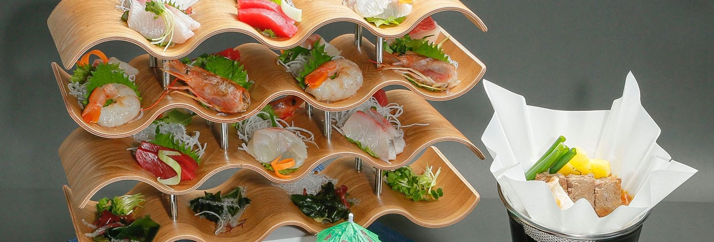 Shrimp and sushi on display trays.