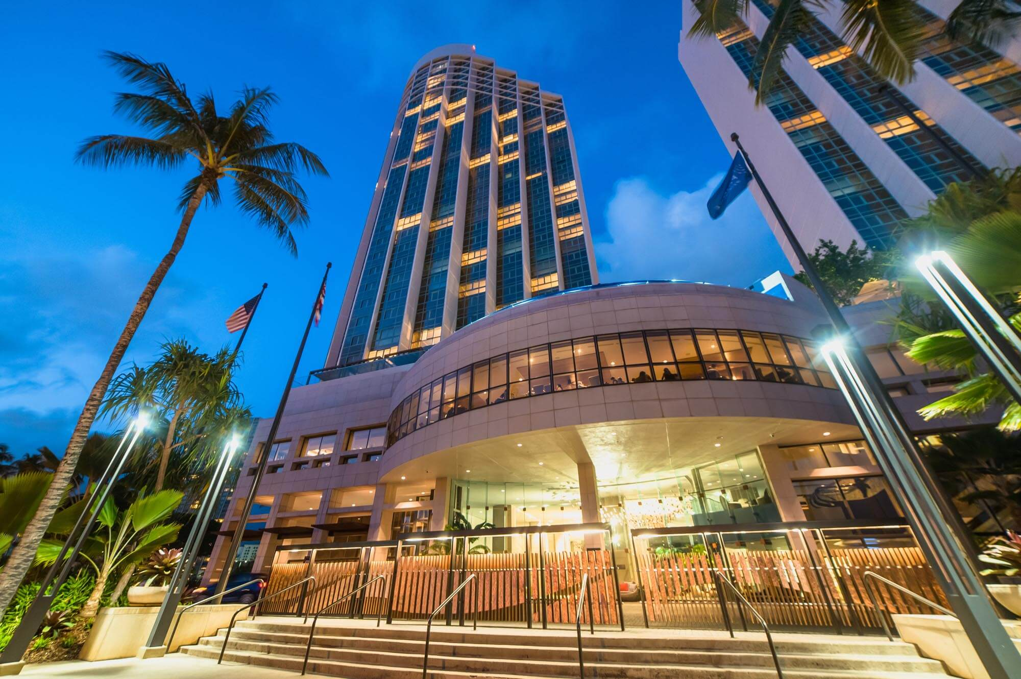 Prince Waikiki hotel exterior at night.