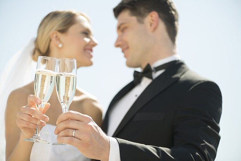 Wedding couple toasting champagne glasses.