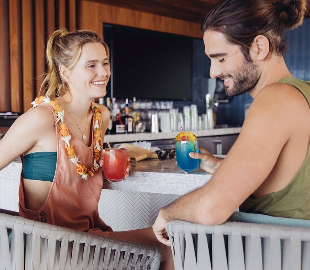 Couple at the bar with drinks.