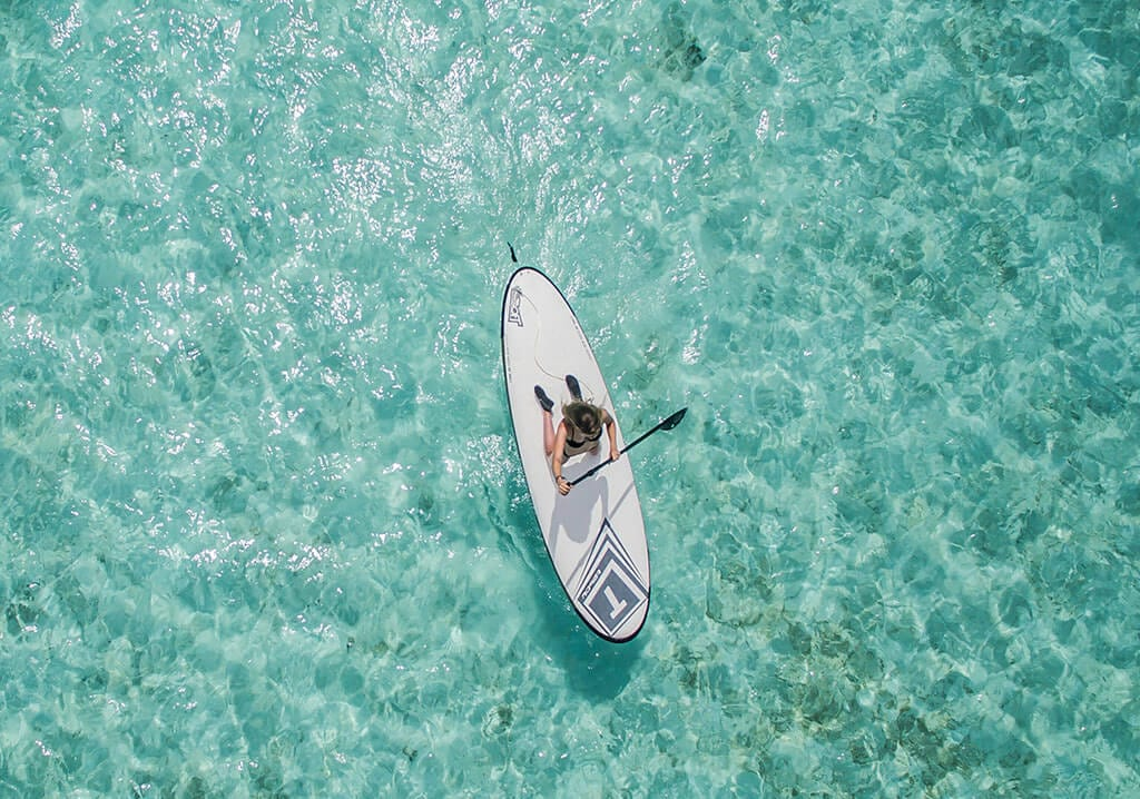 Overhead view of paddleboarder.