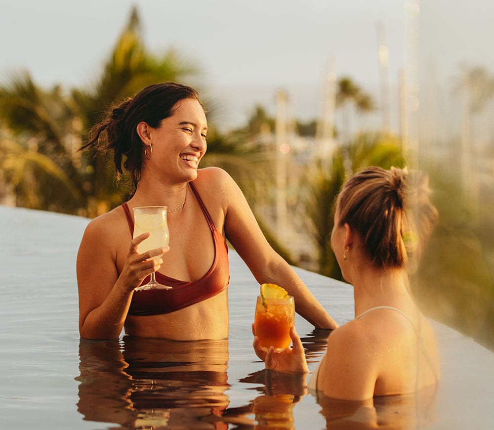 Women in the Infinity Pool with drinks.