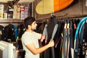 Photo of a Man Shopping at a Honolulu Surf Shop