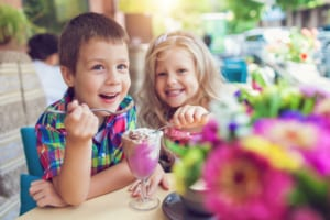 Photo of Two Children Eating Ice Cream, One of the Yummiest Kids Activities in Oahu