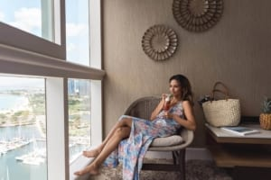 Photo of a woman lounging during a bleisure travel vacation at Prince Waikiki.