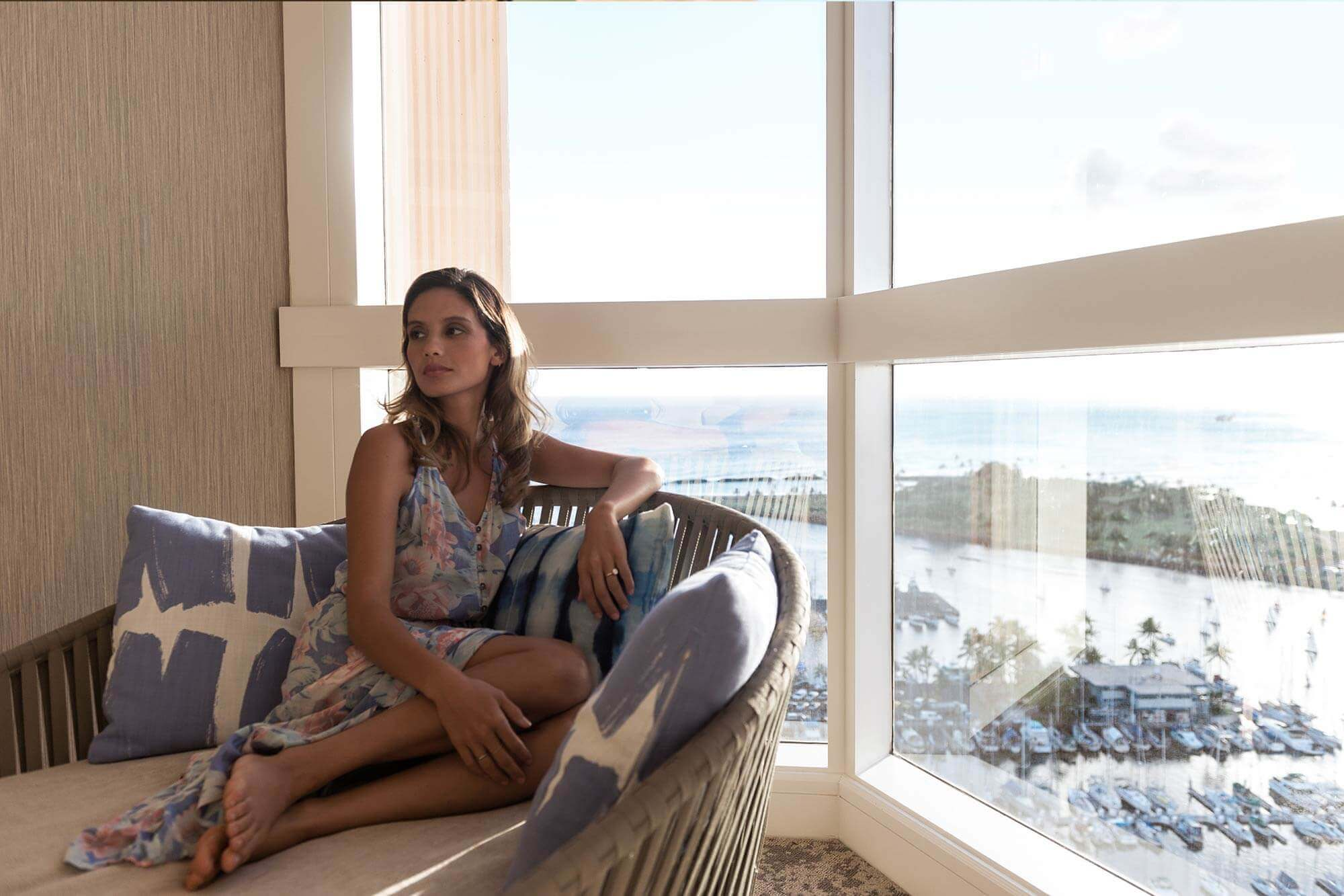 Photo of a Woman Relaxing in a Prince Suite During a Wellness Retreat to Hawaii.
