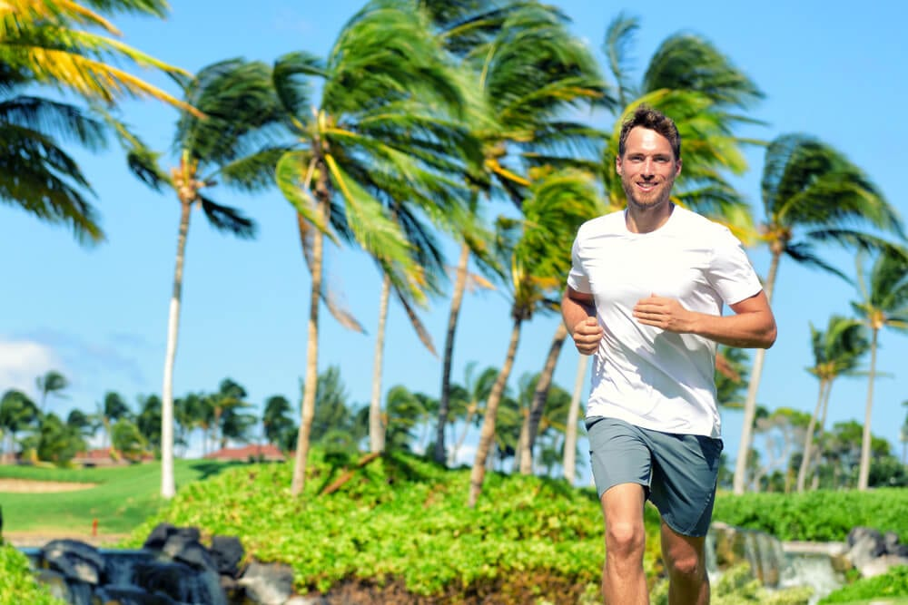 Photo of a Man Jogging in Honolulu During a Self-Instructed Wellness Challenge.