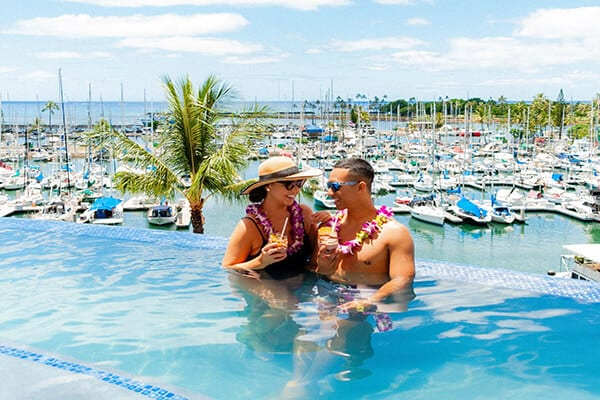 Photo of a Couple in Prince's Infinity Pool. Click Here to Learn About Prince's Hawaii Reopening Plan.