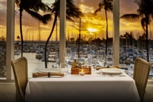 Photo of a Sunset Dinner at 100 Sails. Click Here to Learn about Kayaking in Oahu.