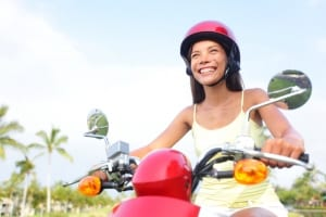 Photo of a Happy Woman on a Scooter Rental in Waikiki.