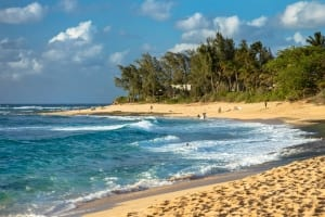 Photo of North Shore's Sunset Beach. This 7-Day Oahu Itinerary is Full of Beachy Fun.