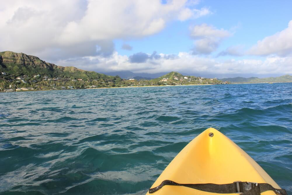 A photo of someone exploring Hawaii waters on a kayak.